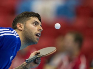 Paraguay's Marcelo Aguirre serves the ball during table tennis team preliminaries at the Pan Am Games in Markham, Ontario Sunday, July 19, 2015. (AP Photo/Rebecca Blackwell)